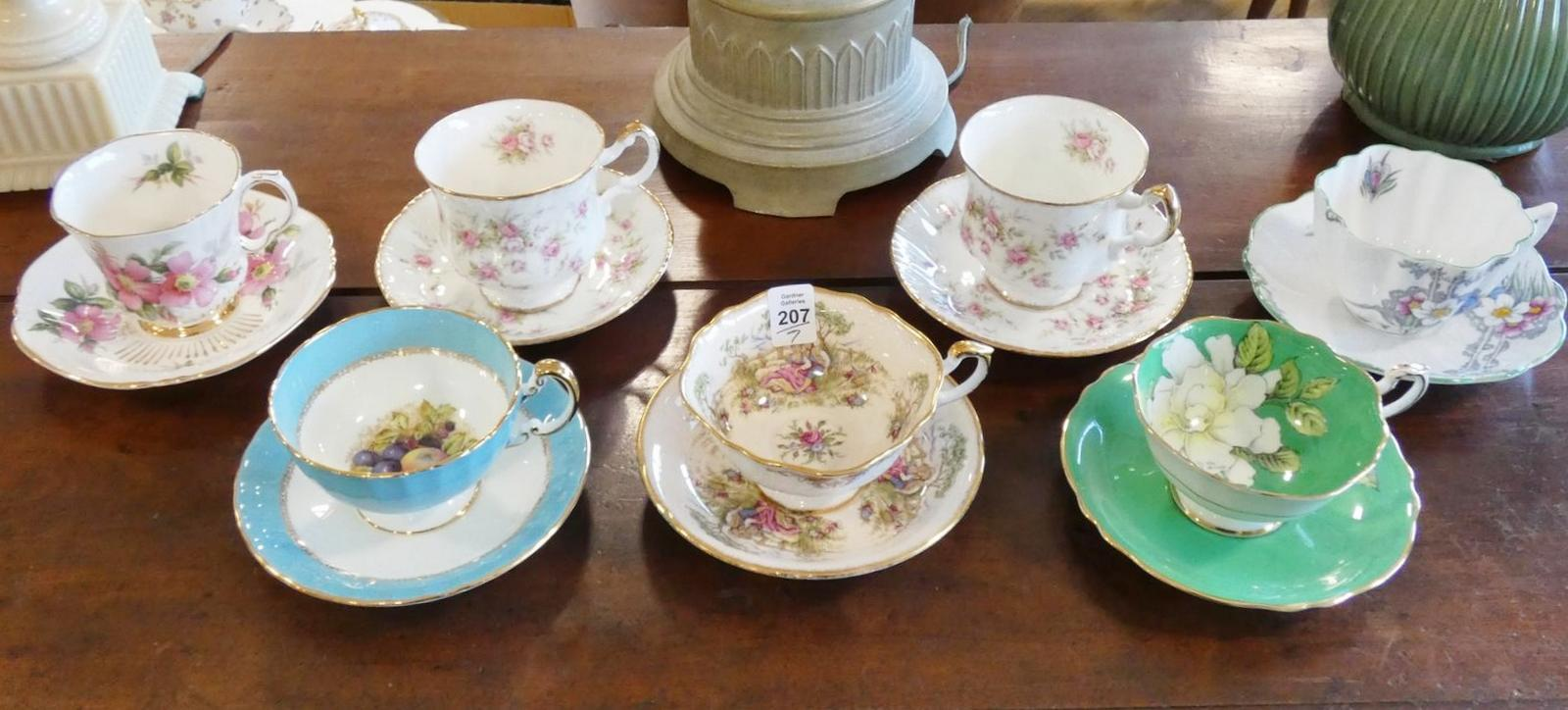 SEVEN CUPS AND SAUCERS