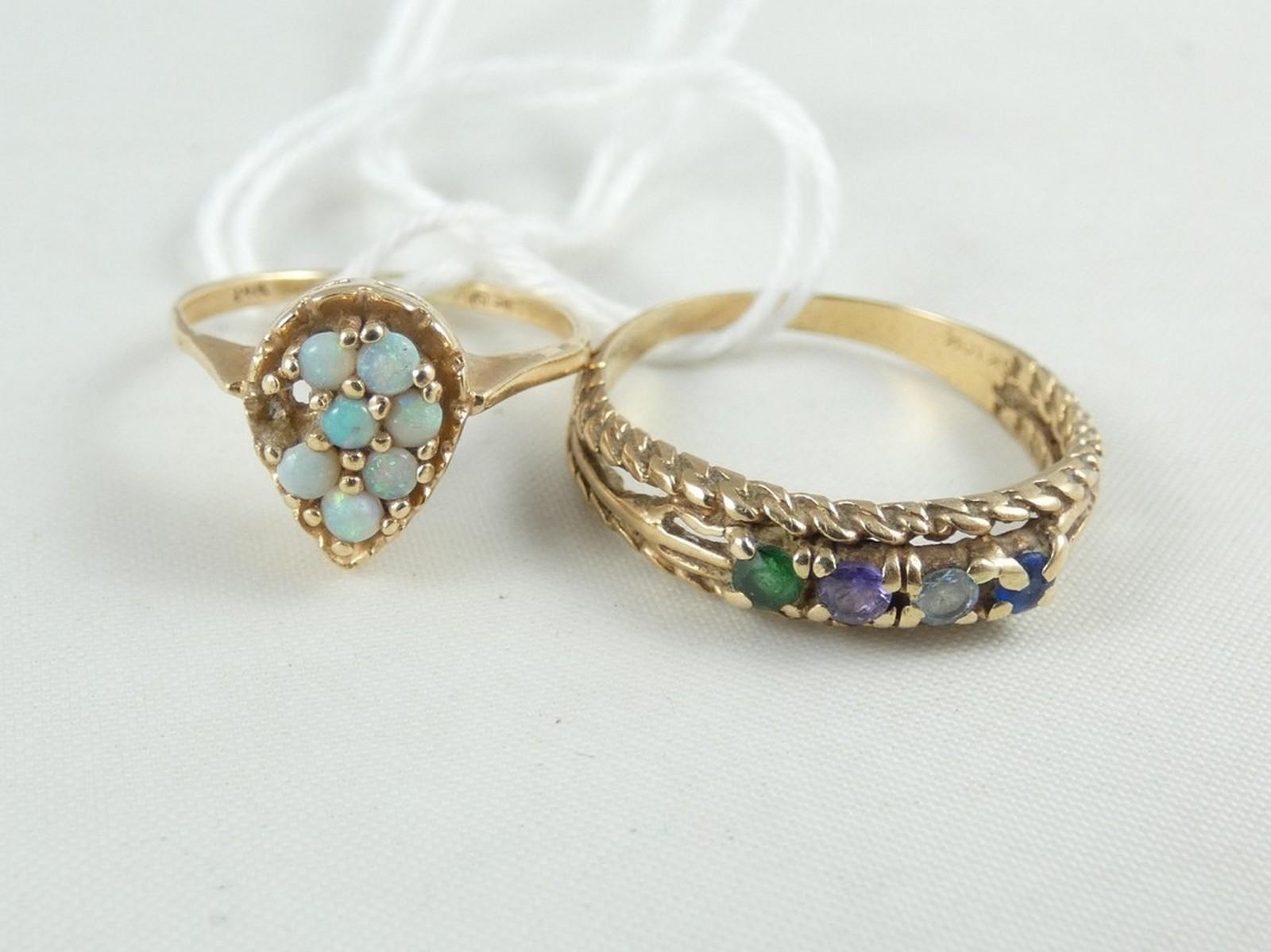 TWO YELLOW GOLD RINGS
