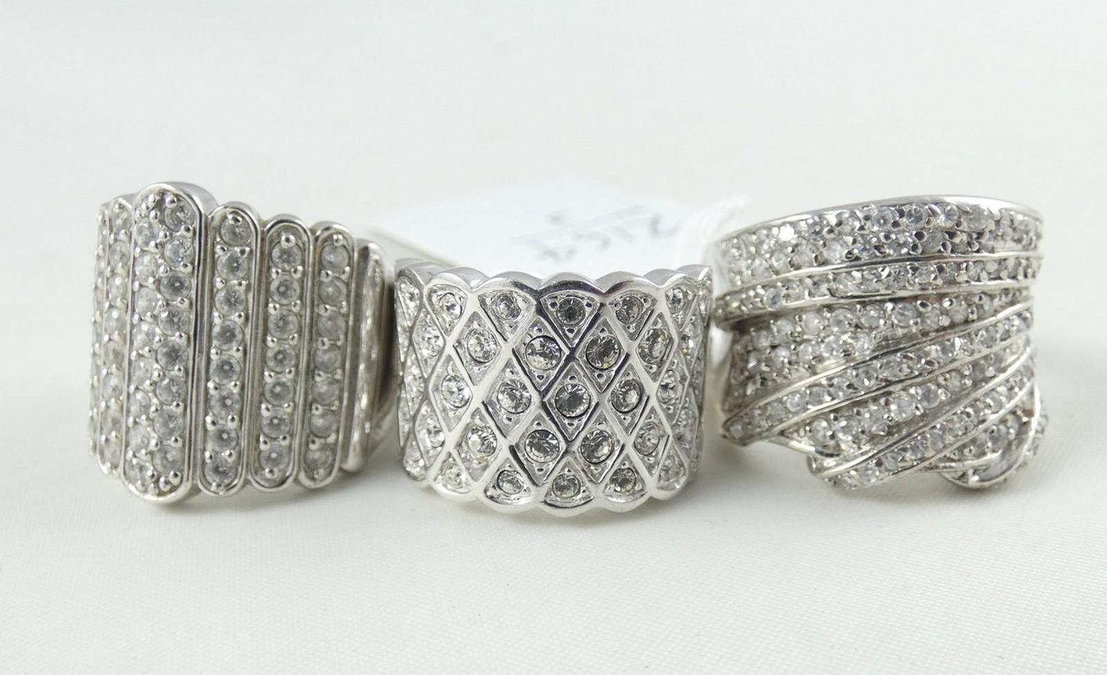 THREE COCKTAIL RINGS