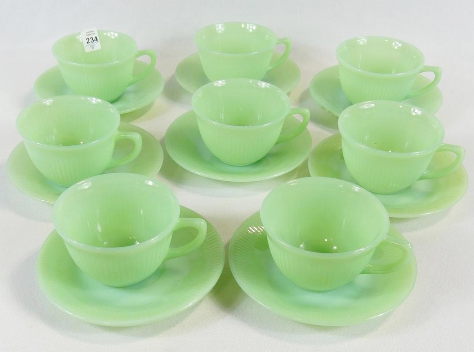 EIGHT FIRE KING CUPS AND SAUCERS
