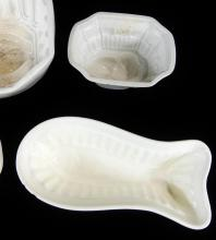 FOUR POTTERY JELLY MOULDS