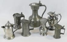SEVEN PEWTER SYRUP JUGS